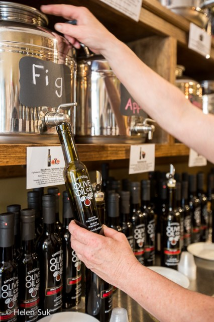 aged balsamic vinegar being poured into a bottle at kingston olive oil company in picton