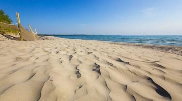golden sand on outlet beach at sandbanks provincial park