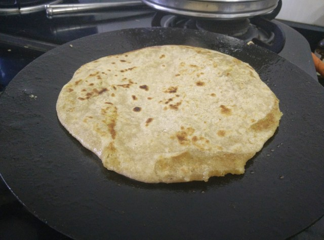 Cook the puran poli on a low flame and smear it with  a dollop of pure ghee