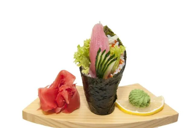 hand rolled sushi in a wooden holder