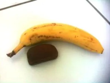 Small Soreen lunchbox loaf next to a banana