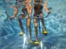 Image of legs in an underwater cycling class