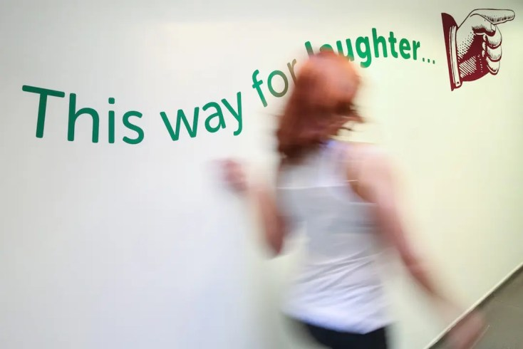 sign that says 'this way to laughter yoga'