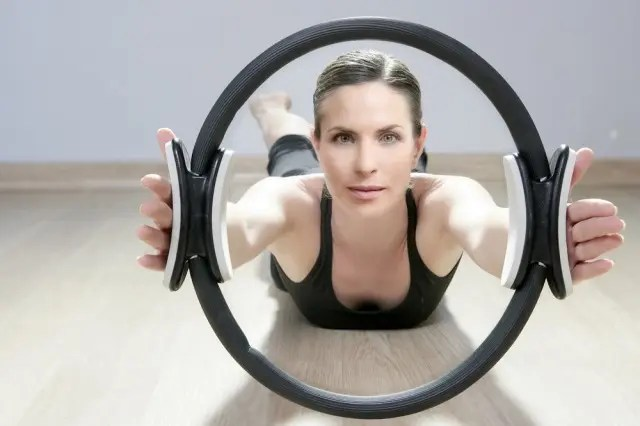 Woman looking through a Pilates Magic Ring