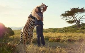 Man hugging tiger