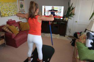 Woman trains virtually with a NouFlex coach
