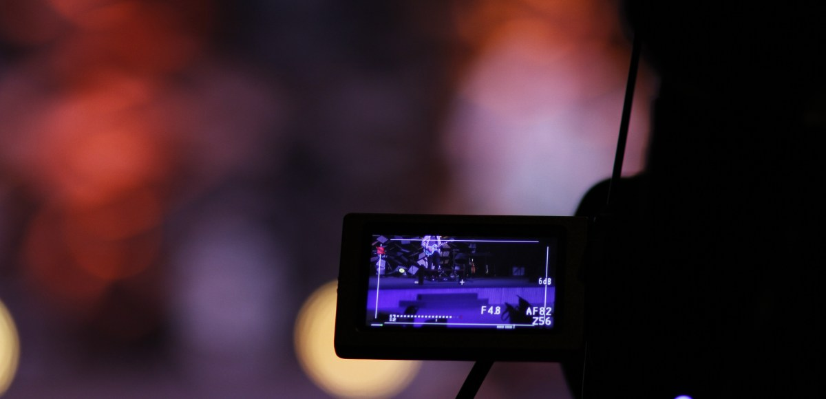 A camera facing a red background