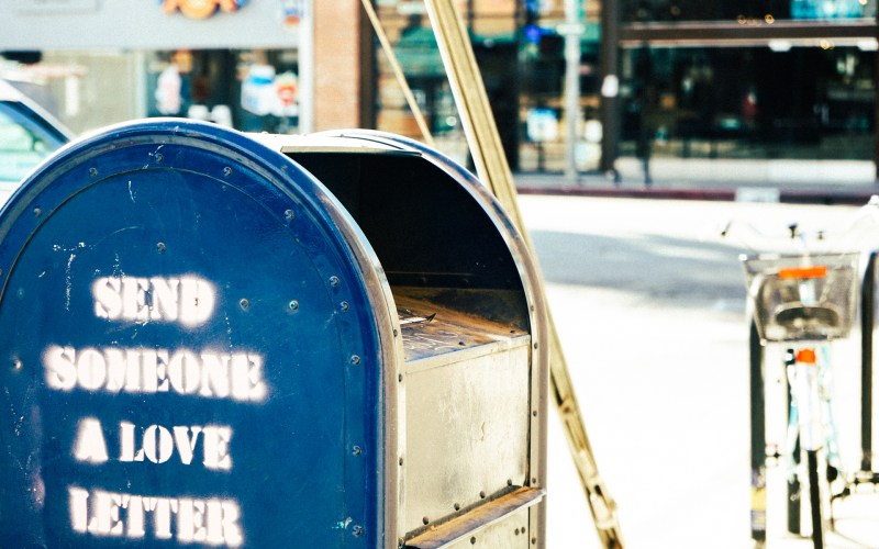 "a blue mailbox that says ""send someone a love letter"""