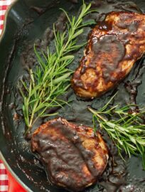 Pan-seared pork chops with a plum balsamic reduction sauce. Delicious dinner tonight!