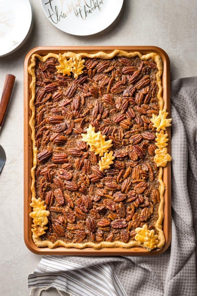 A brown butter slab pecan pie in a pan, baked and ready to serve.