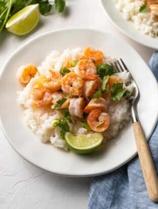 Plate of garlic lime shrimp with coconut rice, ready to eat.