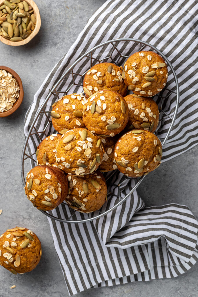 Pumpkin muffins stacked in a basket, ready to share.