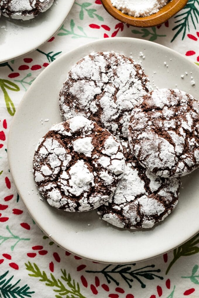 Close-up of chocolate crinkles on a plate.