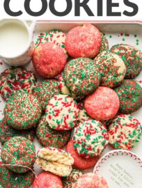These no-roll, no-cut sugar cookies have a smidge of cream cheese to guarantee a smooth, light texture and are coated in beautiful red and green sprinkles for a festive addition to your cookie tray. This recipe is fun and foolproof!
