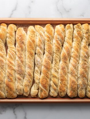 Just-baked homemade breadsticks.