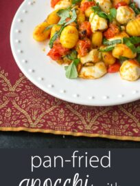 Pan-fried gnocchi with oven-roasted tomatoes, fresh basil, and mozzarella - perfect little indulgence or date night meal!