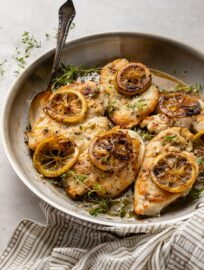 A skillet filled with lemon thyme chicken breasts, a quick and easy weeknight dinner.