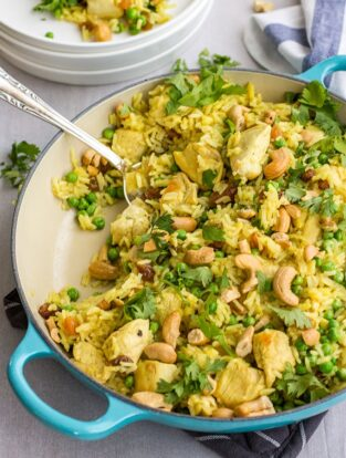 Easy spiced cashew chicken and rice - a quick, delicious one-pot weeknight dinner with curry, cilantro, and fresh ginger.