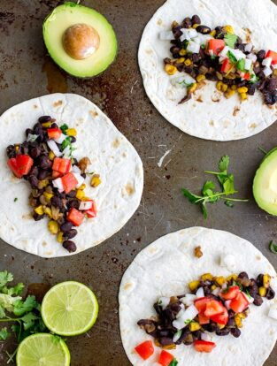 Spicy black bean tacos with corn and pico de gallo   A fast vegetarian Mexican dish, the best quick weeknight dinner and meatless meal!