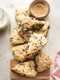Small marble cutting board full of chocolate chip scones.