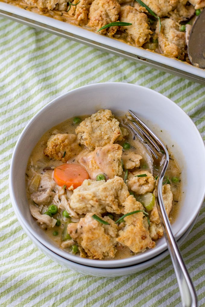 Savory parmesan biscuit crumble chicken pot pie | Ultimate comfort food, chicken pot pie with carrots, celery, mushrooms, a creamy roux, and a simple biscuit topping. #chickenpotpie #comfortfood