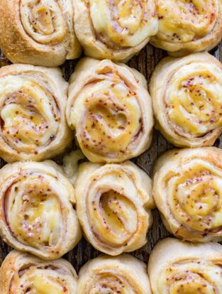 A close-up of turkey gouda party rolls with honey mustard glaze.
