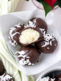 A close-up image of dark chocolate coconut truffles.