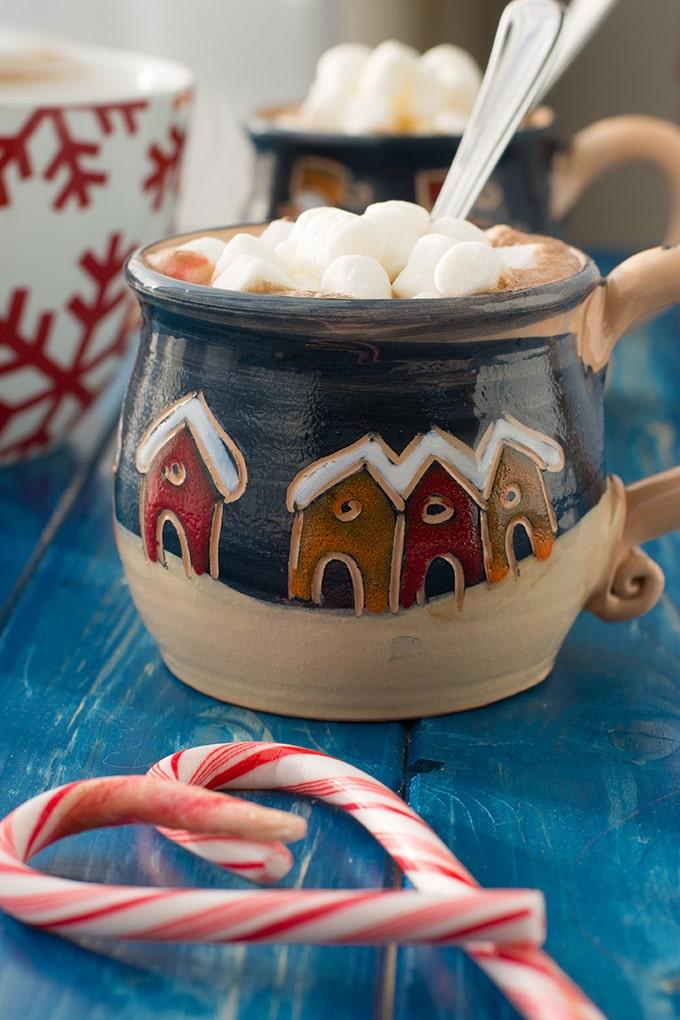 A mug full of classic hot cocoa topped with mini marshmallows.