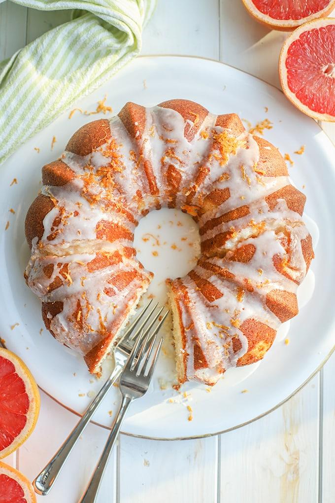 Flat-lay photo of glazed grapefruit bundt cake.
