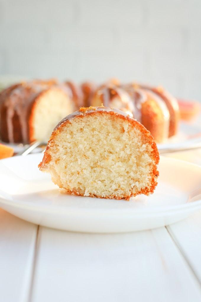 A cut slice of glazed grapefruit bundt cake.