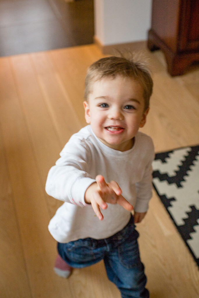 Smiling, running, happy toddler.