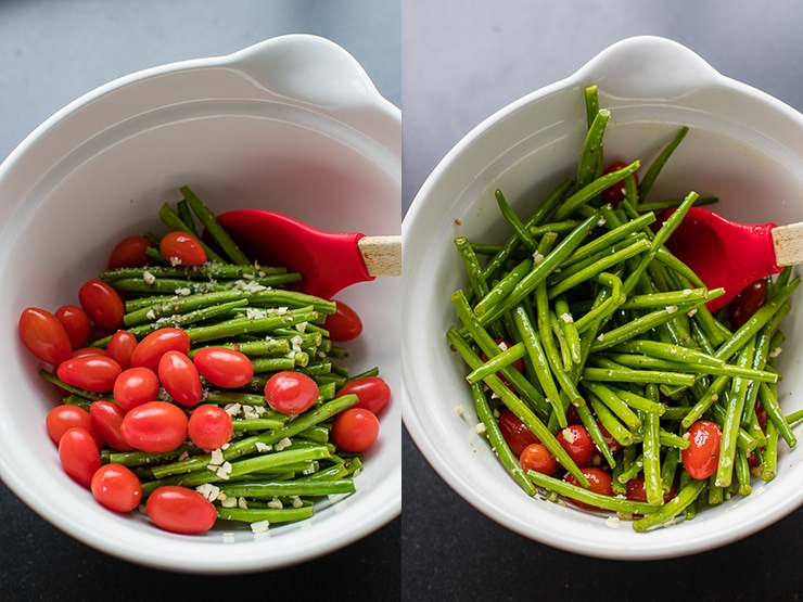 Garlic-seasoned green beans and cherry tomatoes mixed in a white bowl.