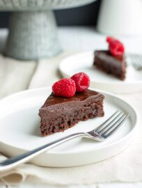 A fudgy, rich chocolate cake that is naturally gluten-free. Make this by hand in one bowl, then top with the easiest chocolate ganache (just chocolate and cream!) and fresh fruit for an impressive party dessert!