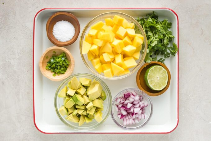 Cut mango, avocado, jalapeno, red onion, cilantro, lime, and salt in prep bowls.