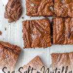 Chocolate hazelnut spread, Nutella, adds the most rich chocolate flavor to these chewy, irresistible brownies topped with a bit of sea salt. #nutella #nutellarecipes #brownies