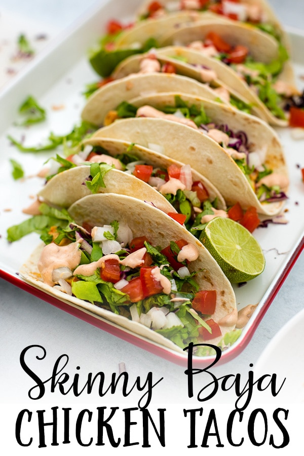 Fresh, flavorful, and ready in less than 30 minutes, skinny Baja chicken tacos just might become a go-to family favorite for quick weeknight meals! Quickly grill or saute seasoned chicken breasts, slice, and top with all the fixings for an easy, delicious Mexican food fix! #chickentacos #bajachicken #mexicanfood #cincodemayo