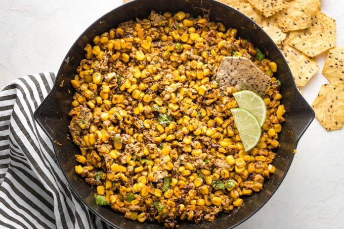 Skillet full of lightened-up chipotle street corn dip.