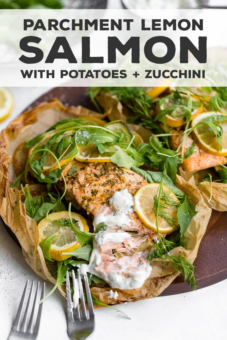 Parchment salmon baked with lemon slices, zucchini, potatoes, and the best light sauce makes an impressive, easy recipe for entertaining, date night, or any night! With a step-by-step visual guide on folding parchment packets - so much easier than you think! #parchmentfish #parchmentsalmon #recipesforentertaining