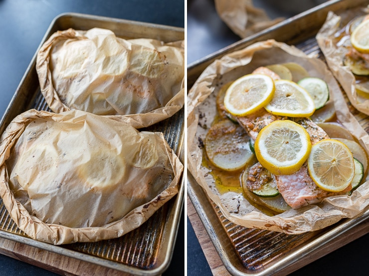 Two servings of salmon folded up in parchment packets.