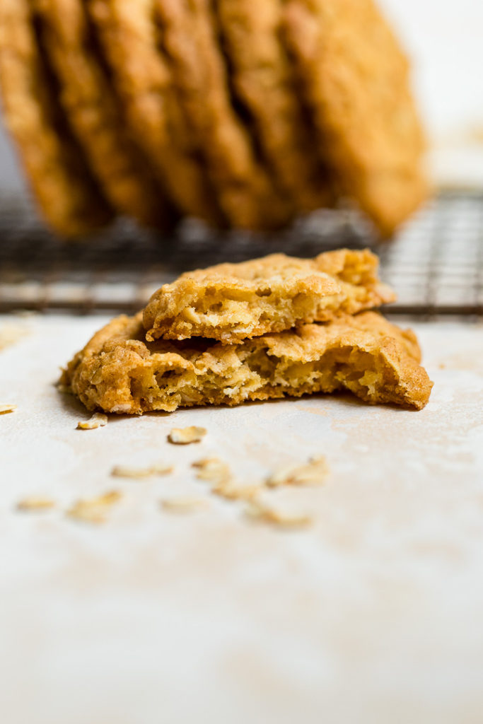 A crisp oatmeal cookie broken in half.