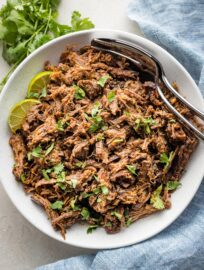 Serving bowl filled with slow cooked barbacoa beef.