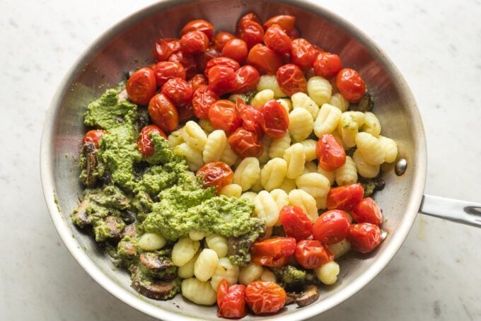 Gnocchi and tomatoes added alongside pesto and mushrooms.