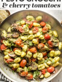 Tender gnocchi pair perfectly with basil pesto and oven-charred cherry tomatoes for an amazing meal ready to eat in 25 minutes!