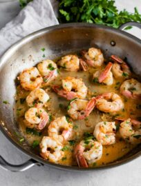 Skillet filled with garlic butter shrimp.
