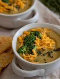 Two bowls of Instant Pot broccoli cheddar soup.