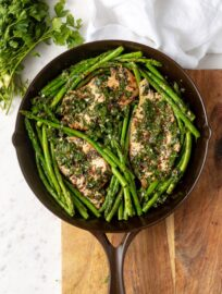 A one-skillet dish of chimichurri chicken with asparagus, featured in a beautiful cast-iron skillet made in the USA by Marquette Castings.