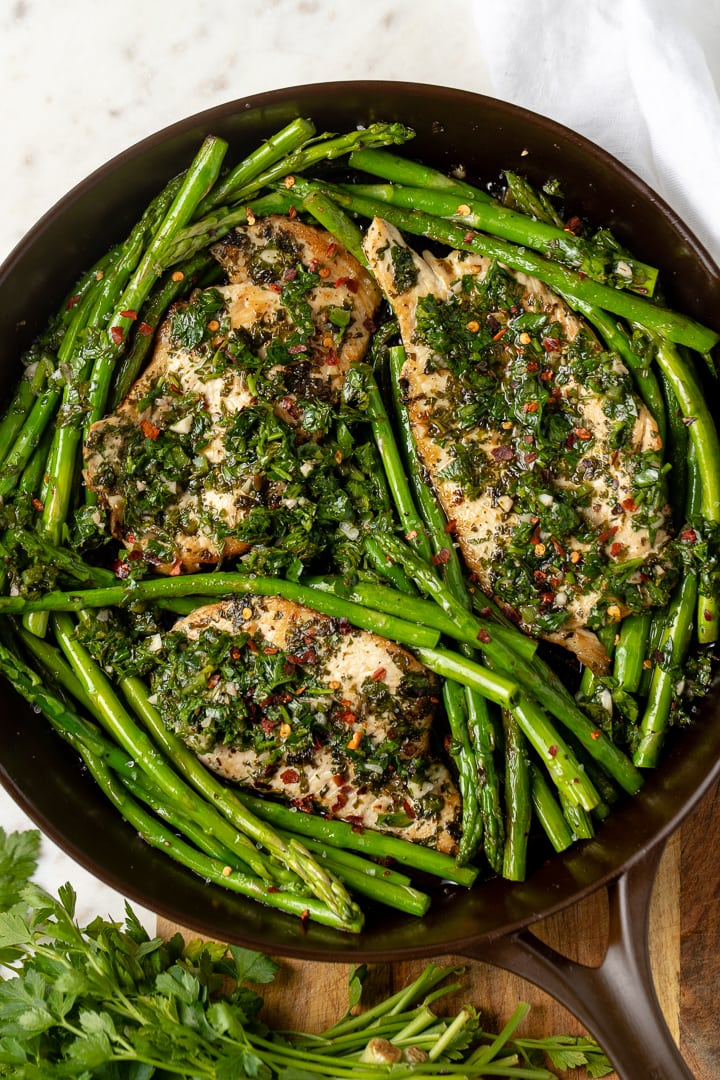 Close-up of chimichurri chicken in skillet.