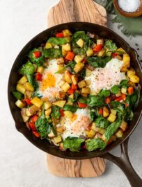 A crispy potato and egg breakfast skillet cooked in cast iron.