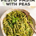 The easiest and most delicious 15 minute fresh pesto pasta with peas! Make your own pesto or use store-bought. Cook the pasta and peas together in one pot. SO good on its own for an easy meal, or serve it as a crazy good side. Perfect with grilled chicken or steaks! #pasta #pesto #easyrecipes