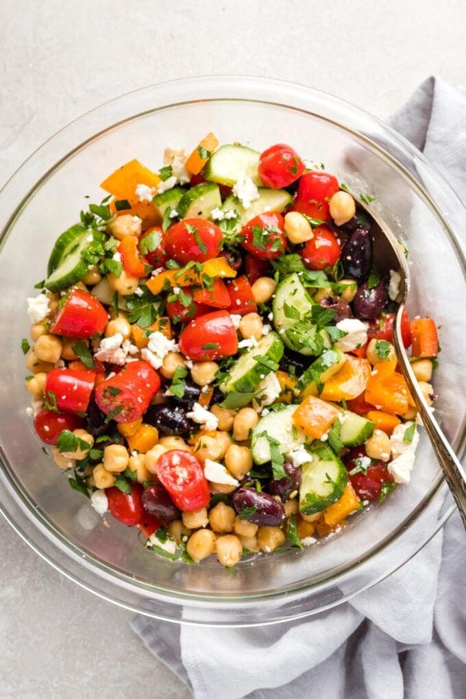 Close-up of chopped Greek chickpea salad in a bowl.